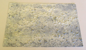 Bees wax, white oil paint, raw linseed, bicarbonate, black pigment